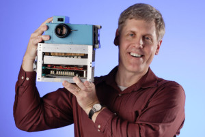 Sasson holding first digital camera